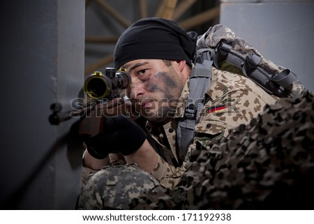 Sniper aiming - military scene making in a studio - stock photo