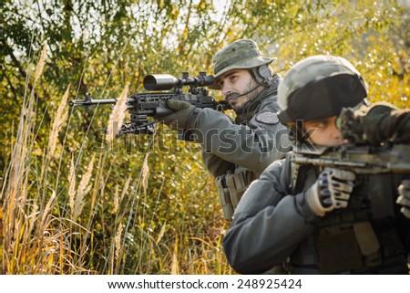 sniper aiming rifle - stock photo