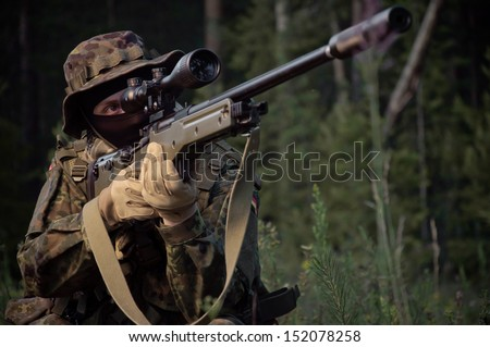 Sniper attack the enemy from a secured position - stock photo