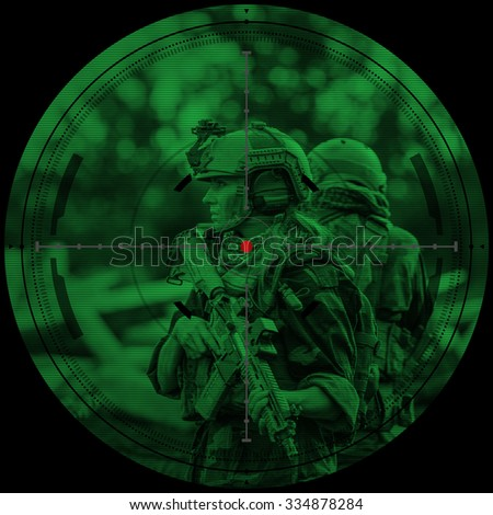 sniper during night mission/operation hostage rescue.view through the night vision scope - stock photo
