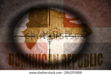 sniper scope aimed at the vintage dominican republic flag and map - stock photo