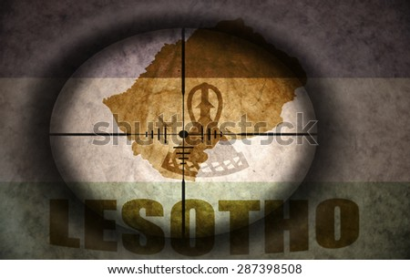 sniper scope aimed at the vintage lesotho flag and map