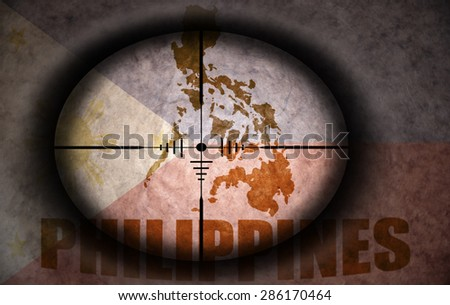 sniper scope aimed at the vintage philippines flag and map - stock photo