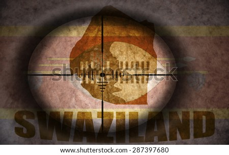 sniper scope aimed at the vintage swaziland flag and map - stock photo