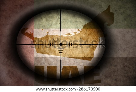 sniper scope aimed at the vintage united arab emirates flag and map - stock photo