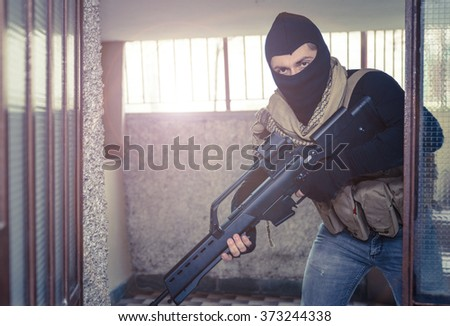 Sniper soldier in action. Concept about war and soft air simulation games - stock photo