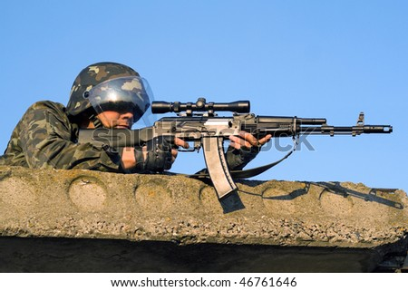 Sniper with machine gun waiting in ambush