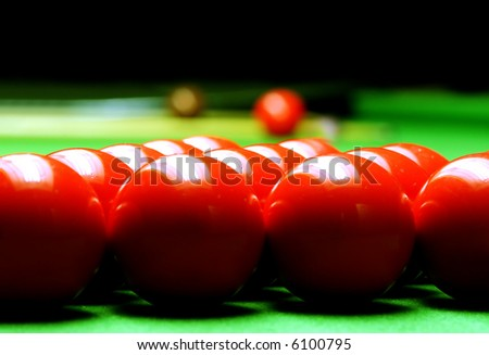 snooker balls on green surface, shallow depth of field
