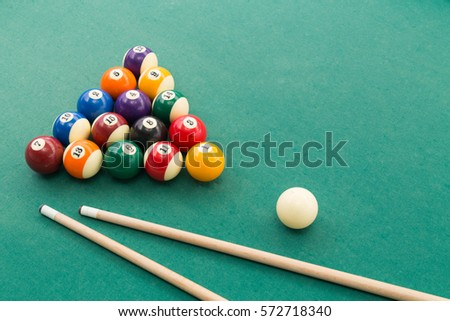Snooker Billards Pool Balls In Triangle And Cue And Extender Stick On Green  Table