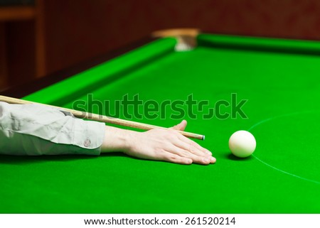 snooker player aiming for white ball - stock photo