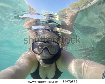 Snorkel woman Underwater image in Mondrago nature reserve Majorca Balearic islands Spain