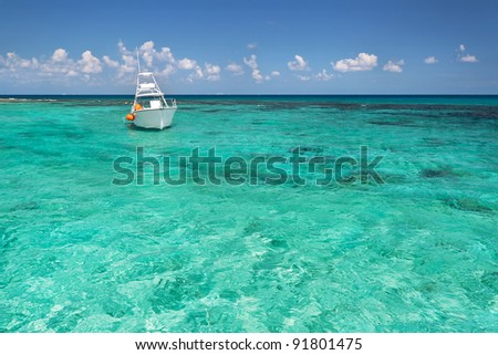 Snorkeling boat on turquise Caribbean Sea of Mexico - stock photo