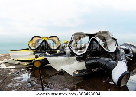 snorkeling equipment for driving on wood platform - stock photo