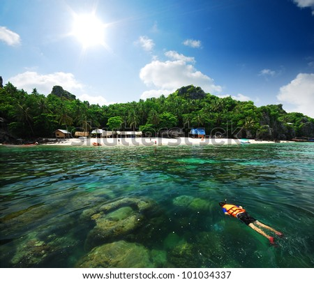 snorkeling in the island sea sand sun beach in thailand