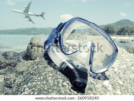 Snorkeling set on Karon beach of Phuket island, Thailand. Washed out look - stock photo