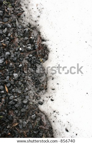 Snow and gravel on the side of the road.  Good for background or texture. - stock photo
