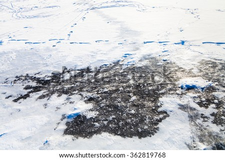 snow and ice at frozen river in cold winter day - stock photo