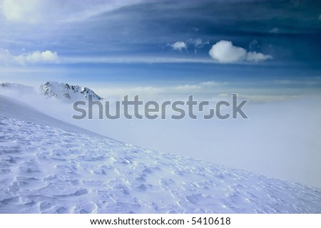 Snow and sky high in the mountains