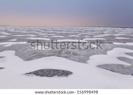 snow and wind texture on frozen Ijsselmeer lake, Netherlands - stock photo