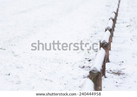 Snow background and wooden fence - stock photo