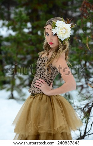 Snow Bride Princess with Headpiece in Forrest During Winter