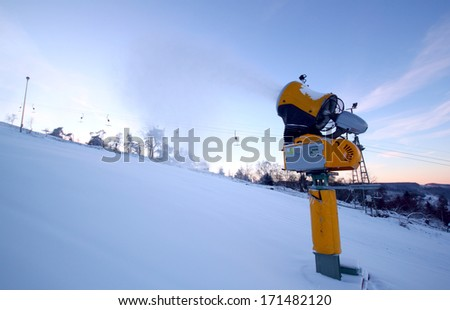 snow cannon and ski lift  - stock photo