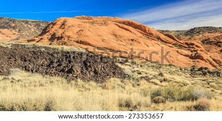 Snow Canyon State Park is a state park of Utah, USA, featuring a canyon carved from the red and white Navajo sandstone in the Red Mountains. The park is located near Ivins, Utah and St. George.