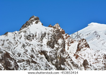 Snow cap on Mount Ruapehu summit with blue sky. It is the highest mountain in the North Island of New Zealand (2020m above sea level) located in Tongariro National Park. - stock photo