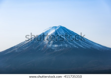 Snow cap, the top of mount fuji in clear sky - stock photo