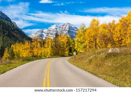 Snow-Capped Maroon Bells and Aspen Trees in Full Fall Color,Maroon Bells Wilderness, Aspen Colorado - stock photo