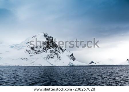 Snow capped mountain in Antarctica - stock photo