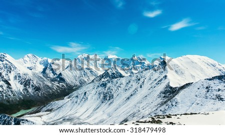 Snow-capped mountains against the blue sky in Altai Republic