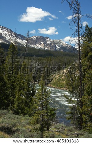 Snow Capped Mountains and River
