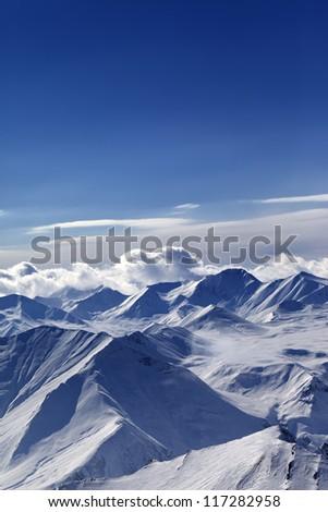 Snow-capped mountains. Caucasus Mountains, Georgia. View from ski resort Gudauri. - stock photo