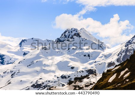 Snow-capped mountains on a blue sky background - stock photo