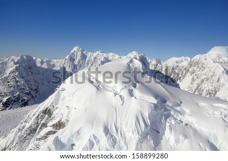 Snow Capped Mountains part of the Alaska Mountain Range in Denali National Park and Preserve - stock photo