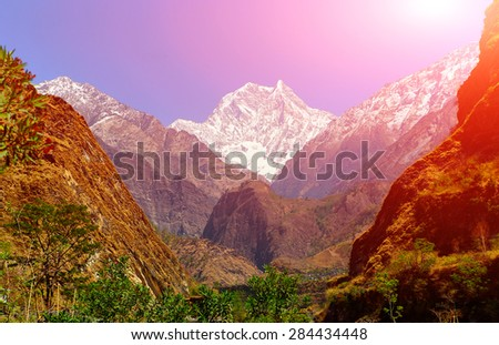 Snow capped mountains. Walley of the mountain river. Himalaya, Nepal - stock photo