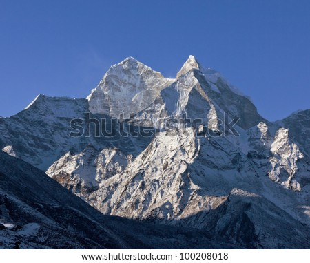 Snow-capped peaks in the area of the Mt. Everest - Nepal, Himalayas - stock photo