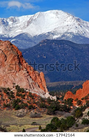 Snow capped Pikes Peak at the east entrance into the Garden of the Gods near Colorado Springs, Colorado - stock photo