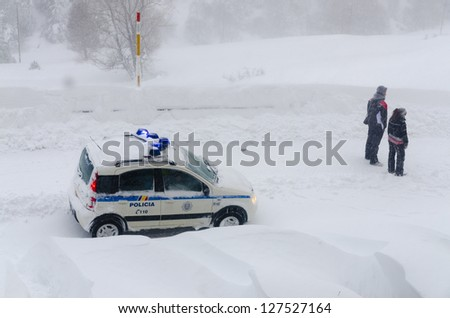 snow car police with people looking the avalanche in Soldeu, Andorra - stock photo
