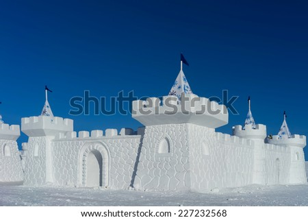 Snow castle in a freezing cold clear day. Christmas playground in Russia. - stock photo