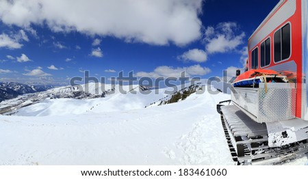 Snow cat on a mountain ridgeline, Utah, USA. - stock photo