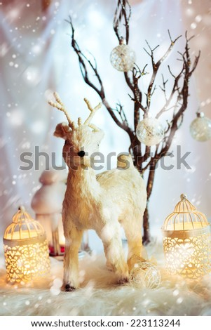 Snow Christmas decoration with fairy white deer and warm candles. Magic holiday background. - stock photo