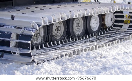 snow-clearing equipment on a snowy background - stock photo