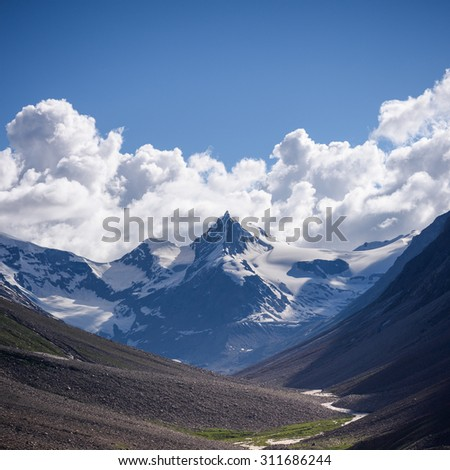 Snow cover top of himalayan moutain, North of India - stock photo