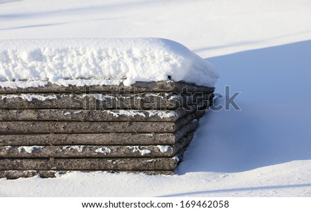 snow cover wood fence in winter season - stock photo