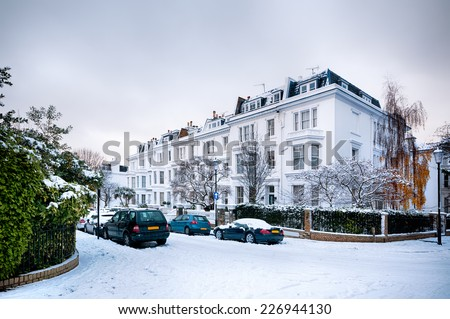 Snow coverd street in Kensington, London - England.  - stock photo