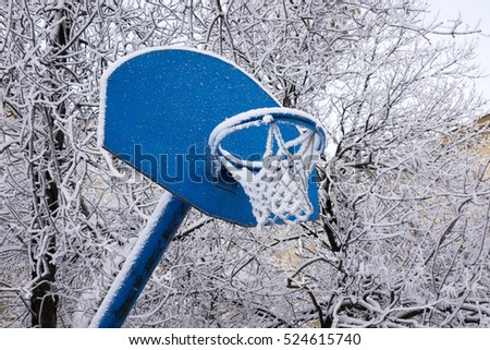 Snow covered basketball hoop