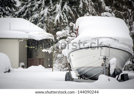 Snow covered boat - stock photo