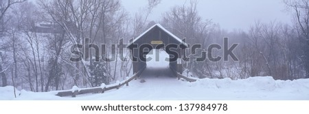 Snow covered bridge in winter in New England - stock photo